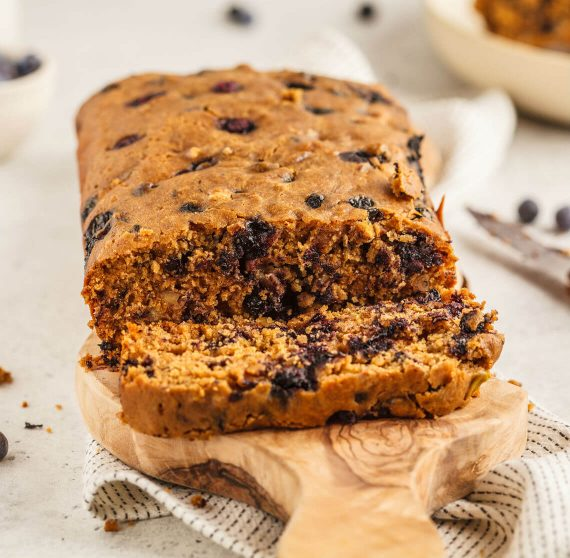 Fresh-baked blueberry bread on a wooden tray