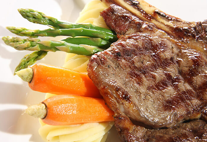Freshly cooked steak dinner on vegetables