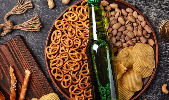Bottle of beer and snacks
