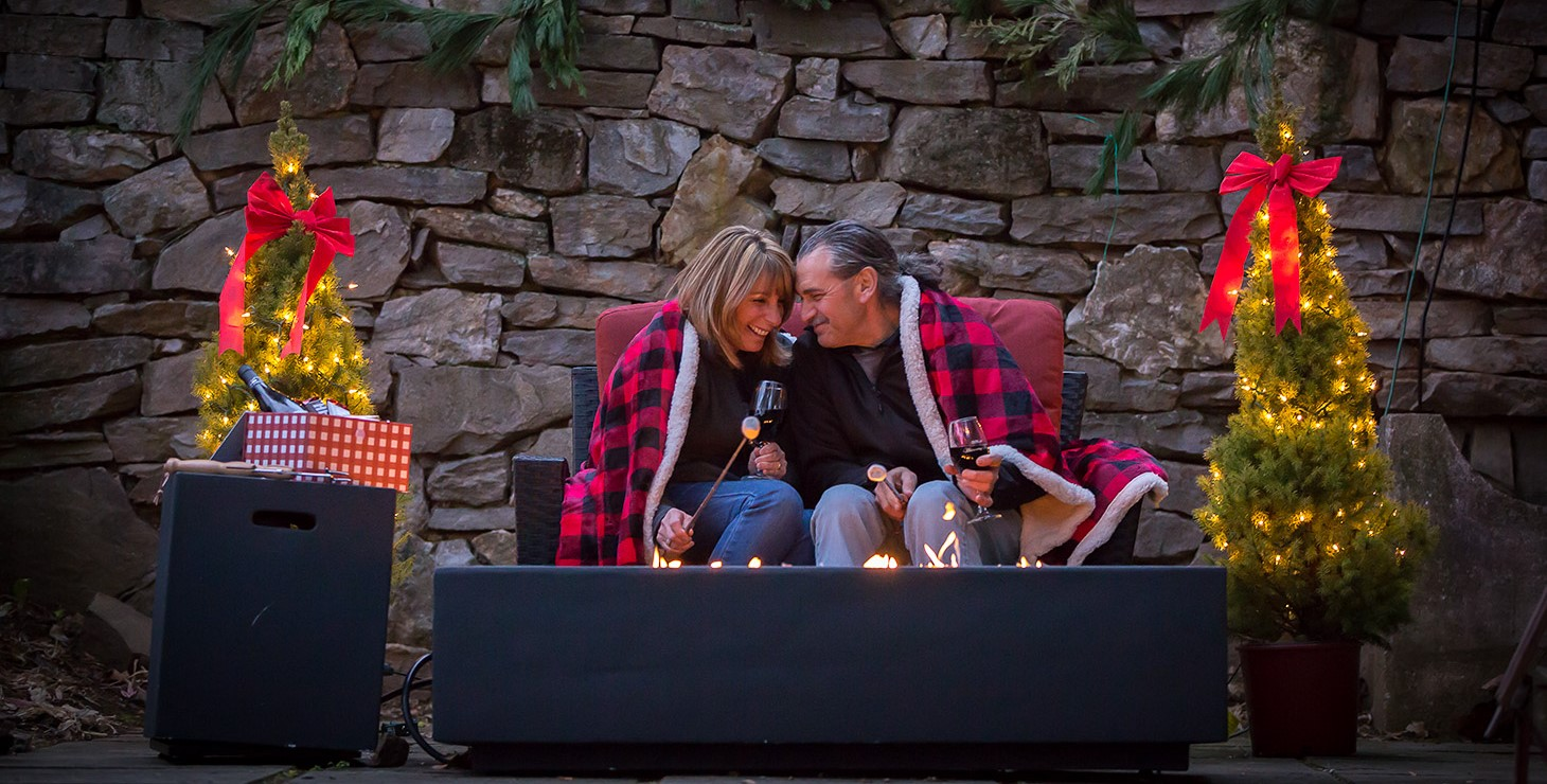 affectionate couple with s'mores kit setup