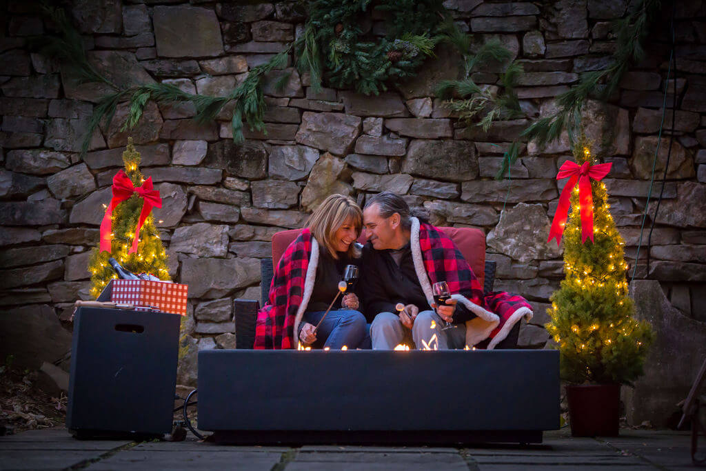 Couple snuggling by a firepit with s'mores at Brandywine inn